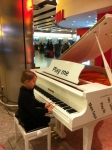 Olivia performing at the Airport before her holiday!