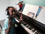 Timi performing and recording his Christmas track.jpg