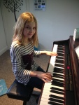 Emily working on her song she wrote in lesson - amazing talent