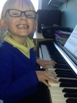 Charlotte, demonstrating good technique on the piano