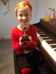 Lily proudly showing medal for school talent show