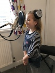 Lily recording her vocals for Don't look back in Anger