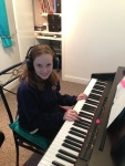 Molly recording her latest song which we mixed together in lesson.